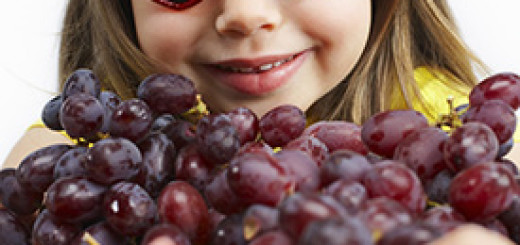 Girl Holding Red Grapes